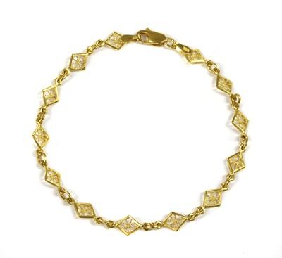 Lot 63 - A 22ct gold lozenge link bracelet