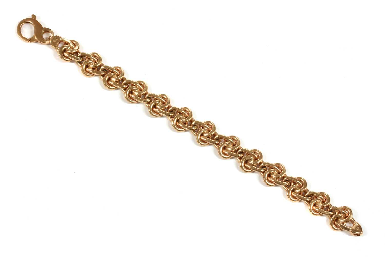 Lot 62 - A 9ct rose gold hollow knot link bracelet