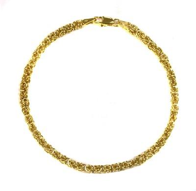 Lot 54 - An 18ct gold hollow Byzantine link bracelet
