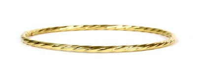 Lot 44 - An 18ct gold hollow twisted wire bangle