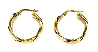 Lot 74 - A pair of 9ct white and yellow gold twisted wire hoop earrings