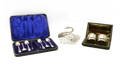 Lot 7 - A pair of cased silver napkin rings