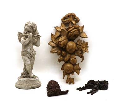 Lot 31 - A carved and painted wooden figure of a cherub playing a flute