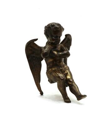Lot 93 - A 19th century bronze model of a seated cherub