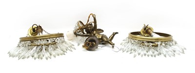 Lot 97A - A pair of cut glass and brass chandeliers of three waterfall graduated tiers