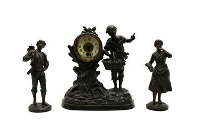 Lot 30 - A spelter clock garniture