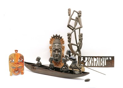 Lot 99 - A North African carved hardwood model of a tribal rowing boat