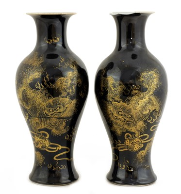 Lot 27 - A pair of Chinese black-glazed vases