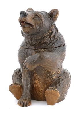 Lot 64 - A Black Forest carved wooden bear tobacco jar