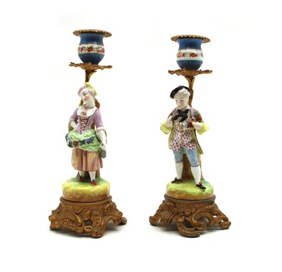 Lot 46 - Two pairs of candlesticks and a lamp base