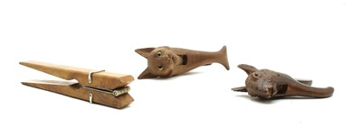 Lot 68 - Three pairs of wooden novelty nut crackers