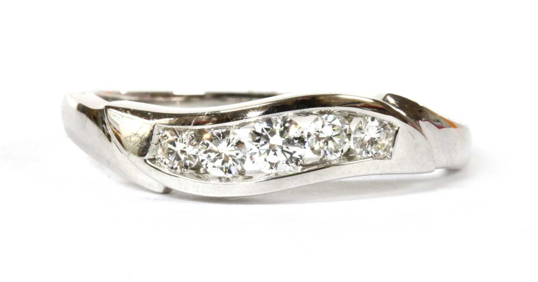 Lot 83 - An 18ct white gold five stone diamond ring