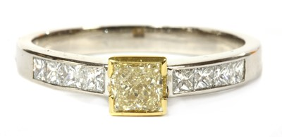 Lot 78 - An 18ct white gold fancy yellow diamond ring