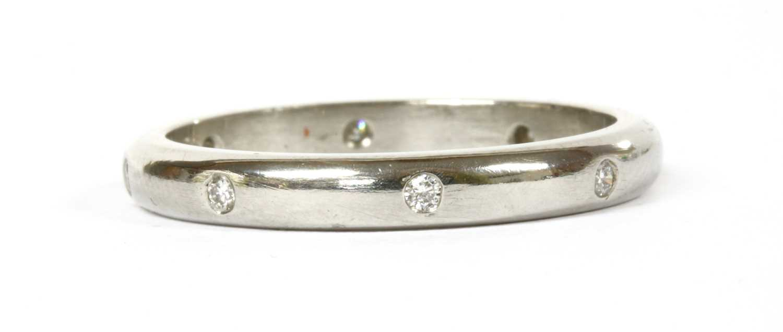 Lot 96 - A platinum diamond set band ring