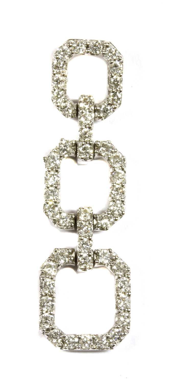 Lot 87 - An 18ct white gold diamond pendant