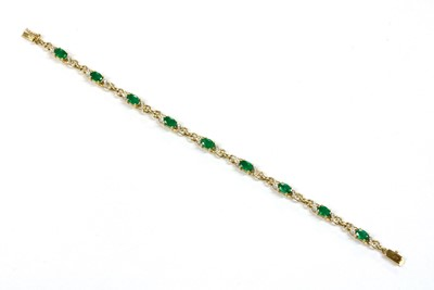 Lot 101 - A 9ct gold emerald and diamond bracelet