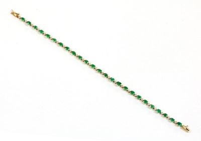 Lot 103 - A 9ct gold emerald and diamond bracelet