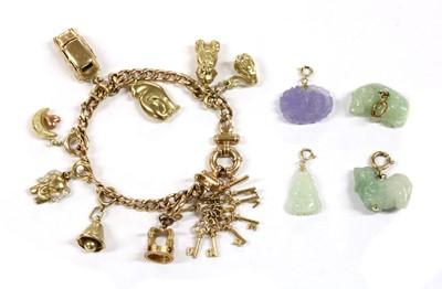 Lot 49 - A 9ct gold charm bracelet