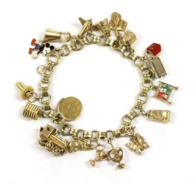 Lot 50 - A Continental gold charm bracelet