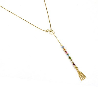 Lot 104 - A gold glass bead lariat necklace