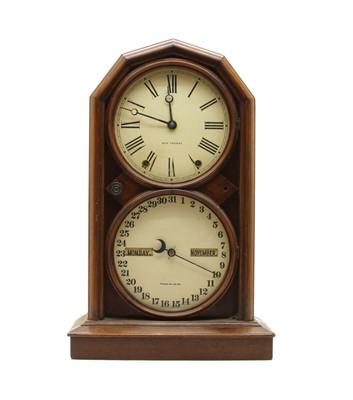 Lot 51 - An American walnut cased calendar clock