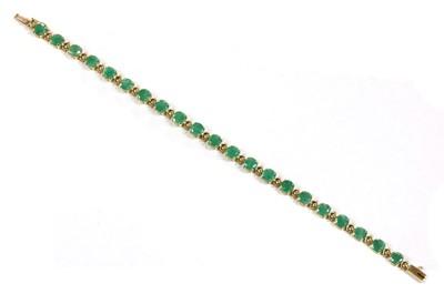 Lot 108 - A 9ct gold emerald bracelet