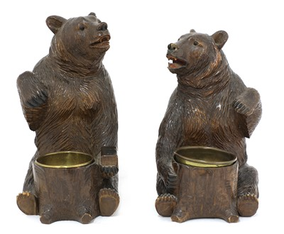 Lot 63 - A near opposing pair of carved Black Forest bear ashtrays