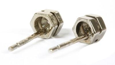 Lot 90 - A pair of 18ct white gold single stone diamond stud earrings