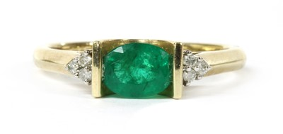 Lot 106 - A 9ct gold emerald and diamond ring