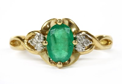 Lot 104 - A 9ct gold emerald and diamond ring