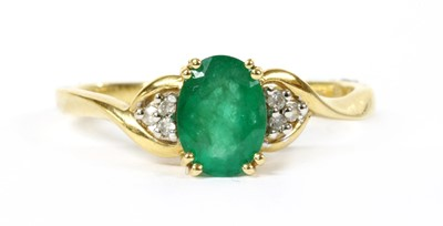 Lot 102 - A 9ct gold emerald and diamond ring