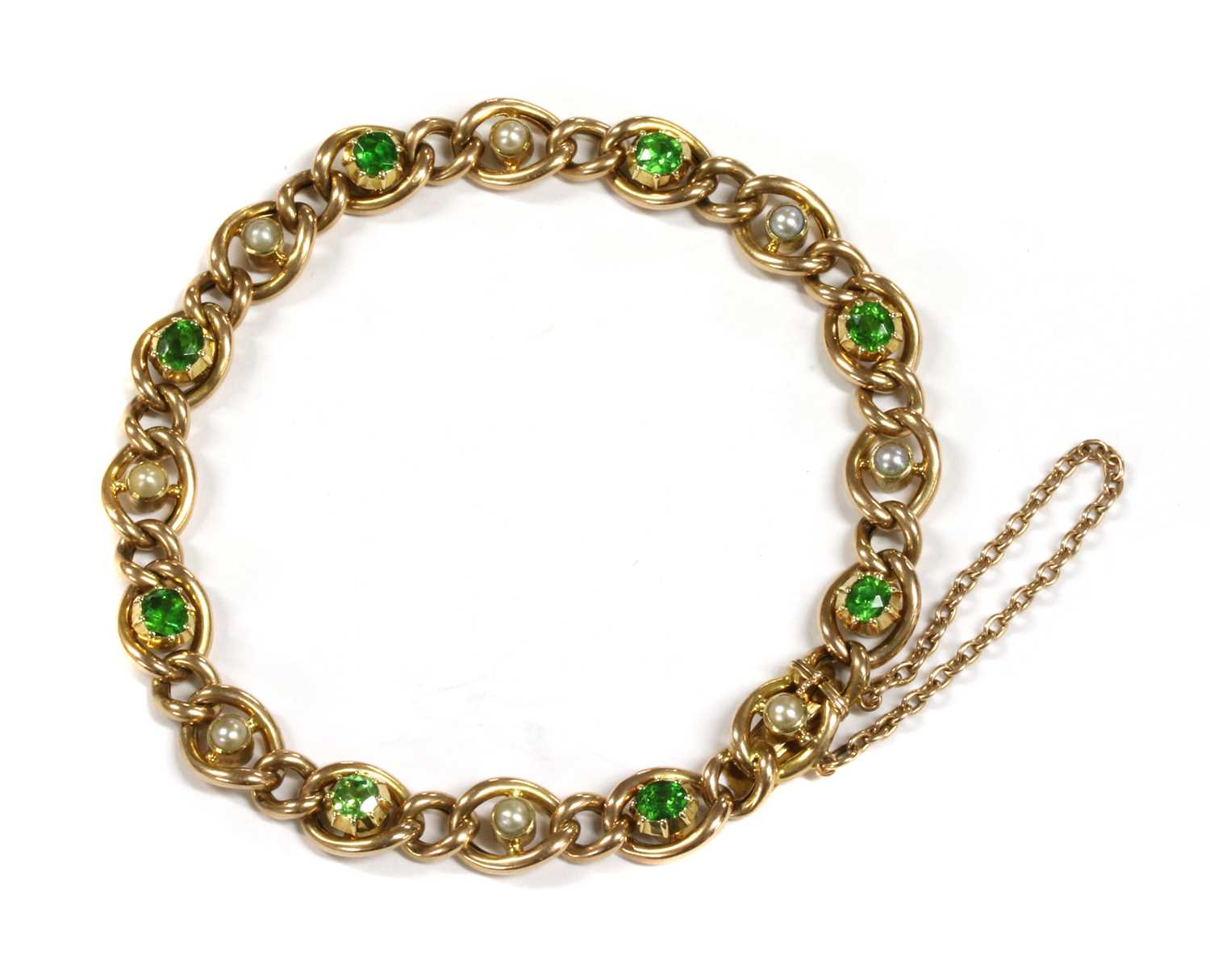 Lot 1 - A Victorian gold demantoid garnet and split pearl curb bracelet