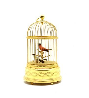 Lot 101 - A modern gilt singing birdcage music box