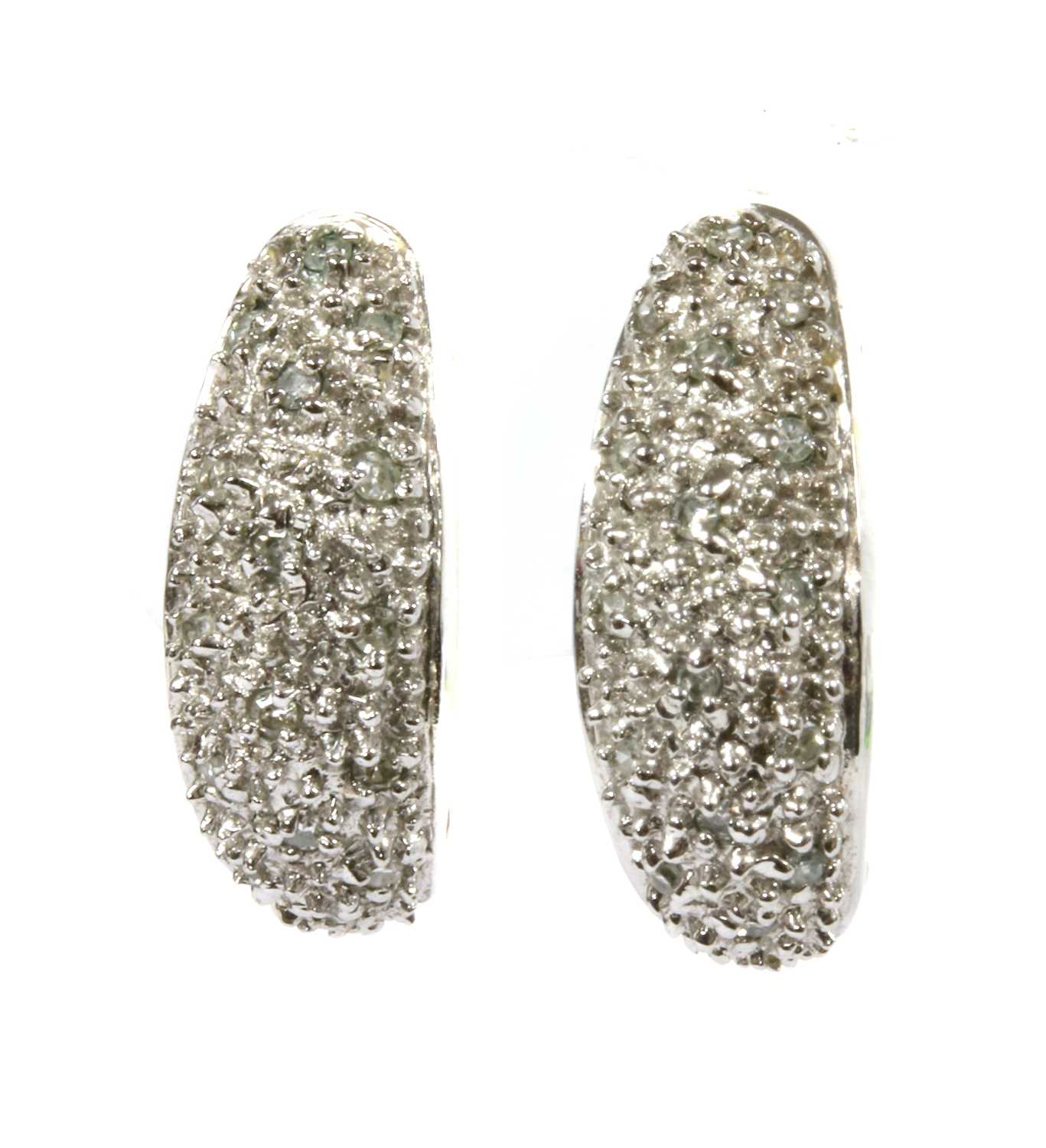 Lot 88 - A pair of 9ct white gold diamond set 'J' hoop earrings