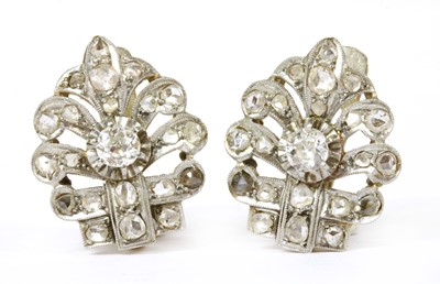 Lot 11 - A pair of Continental silver and gold diamond set earrings