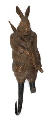 Lot 60 - A Black forest carved linden wood and horn musical hook