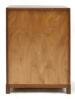 Lot 392 - A walnut crossbanded chest of drawers