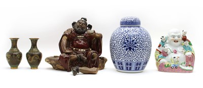Lot 85 - A Chinese pottery deity