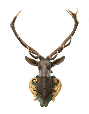 Lot 59 - A carved and polychrome painted wooden stag head