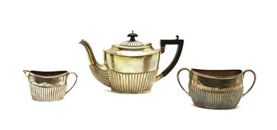 Lot 12 - A matched silver three-piece tea set