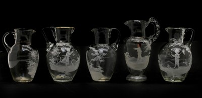Lot 59 - Five clear glass 'Mary Gregory' jugs