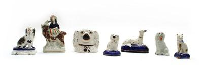 Lot 79 - Thirteen Staffordshire pottery animals