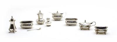 Lot 18 - Two silver cruet sets