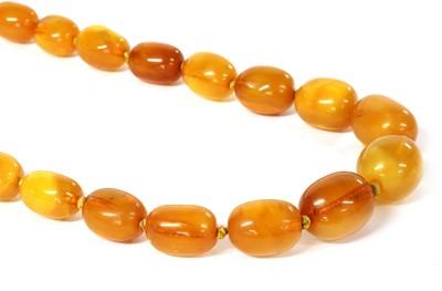 Lot 25 - A single row graduated amber bead necklace
