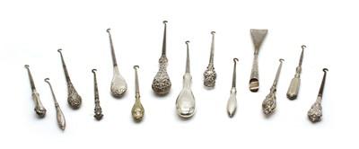 Lot 16 - Twenty six silver handled button hooks and shoe horns