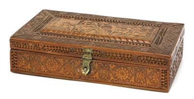 Lot 95 - A Persian Qajar carved fruitwood box