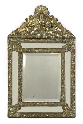 Lot 83 - A Flemish brass mirror