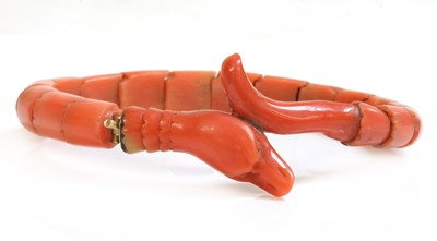 Lot 107 - A late Victorian carved coral graduated snake bracelet, or semi flexible bangle