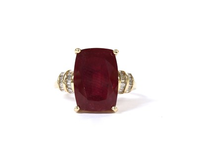 Lot 105 - A gold fracture filled ruby and diamond ring