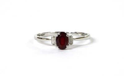 Lot 115 - A white gold three stone ruby and diamond ring